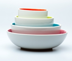 4 Nested White Bowls On White Background